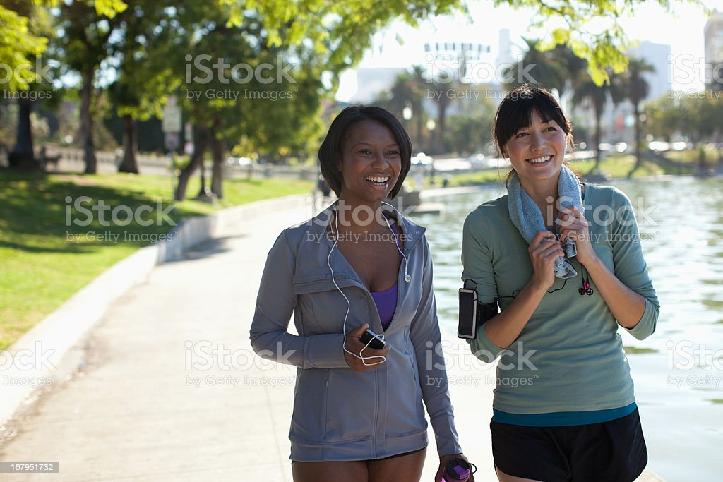 Women standing together in park royalty-free stock photo