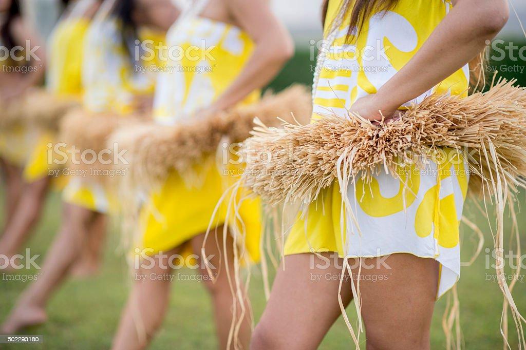 Women Starting a Luau Performance stock photo