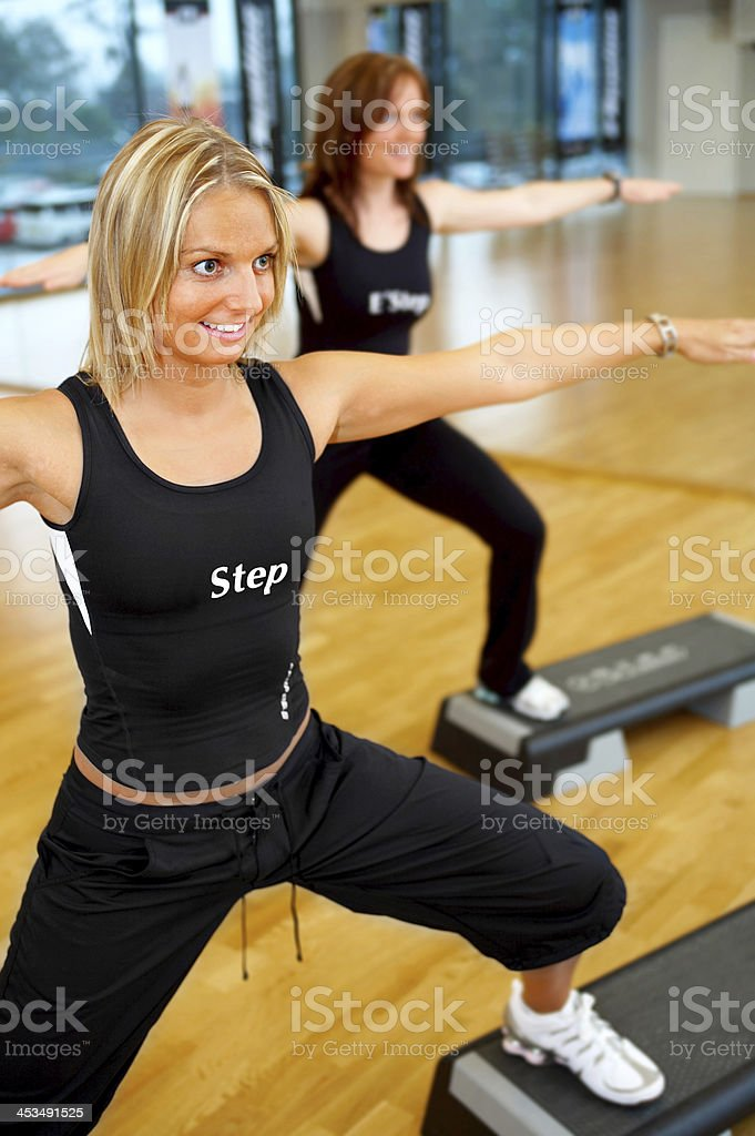 Women stepping in a fitness center royalty-free stock photo
