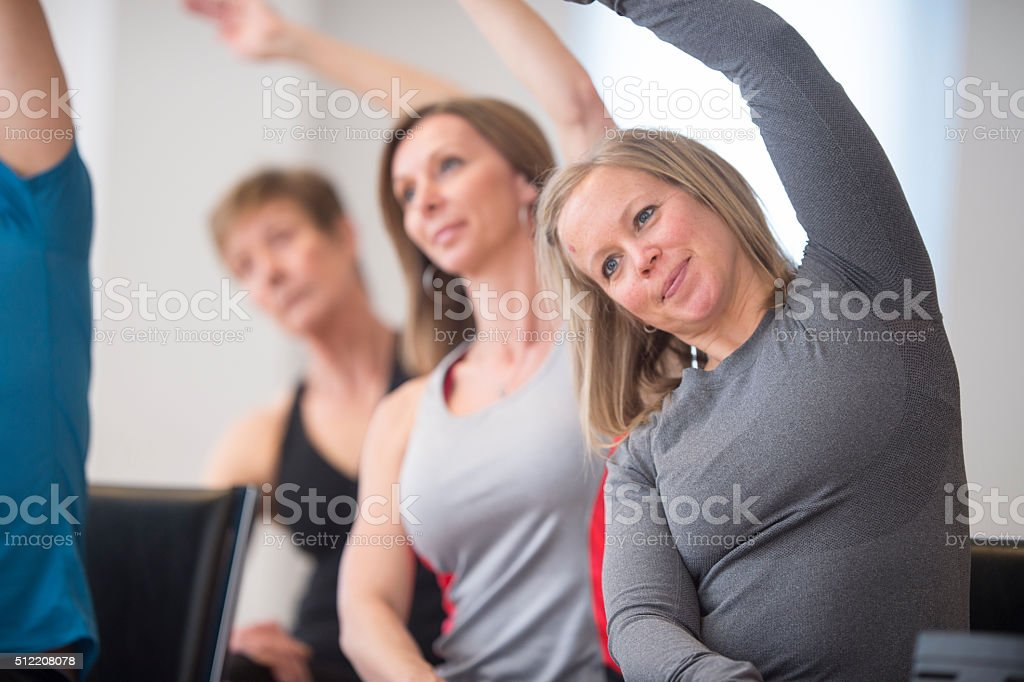 Women Stretching Their Arms Overhead stock photo