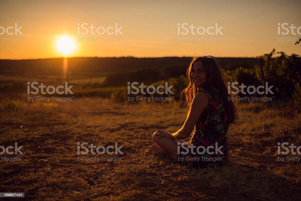 women sunset vineyard stock photo