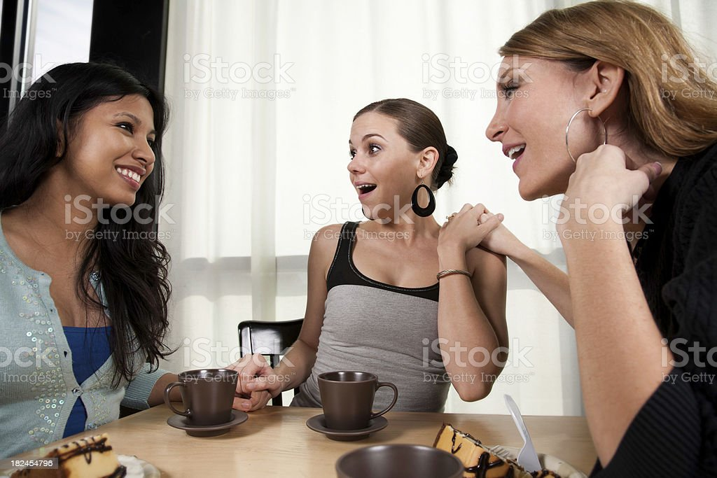 Women Surprised About Friend Telling Them Great News royalty-free stock photo