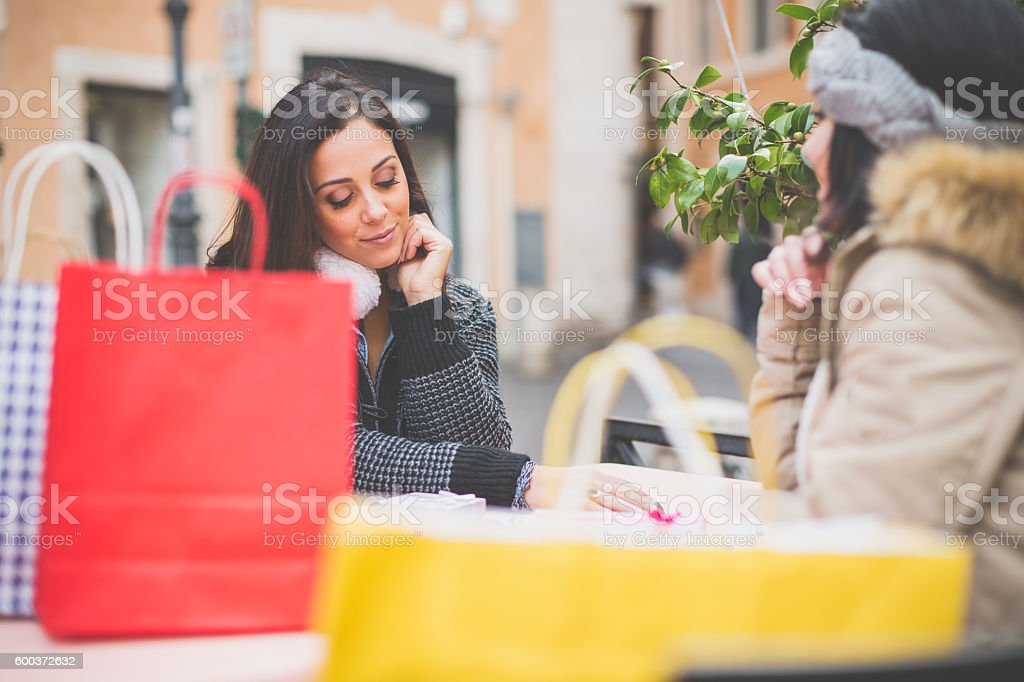 Women take a coffee during shopping stock photo