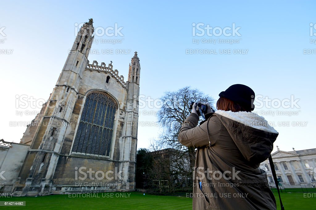 women take a photo Cambridge University royalty-free stock photo