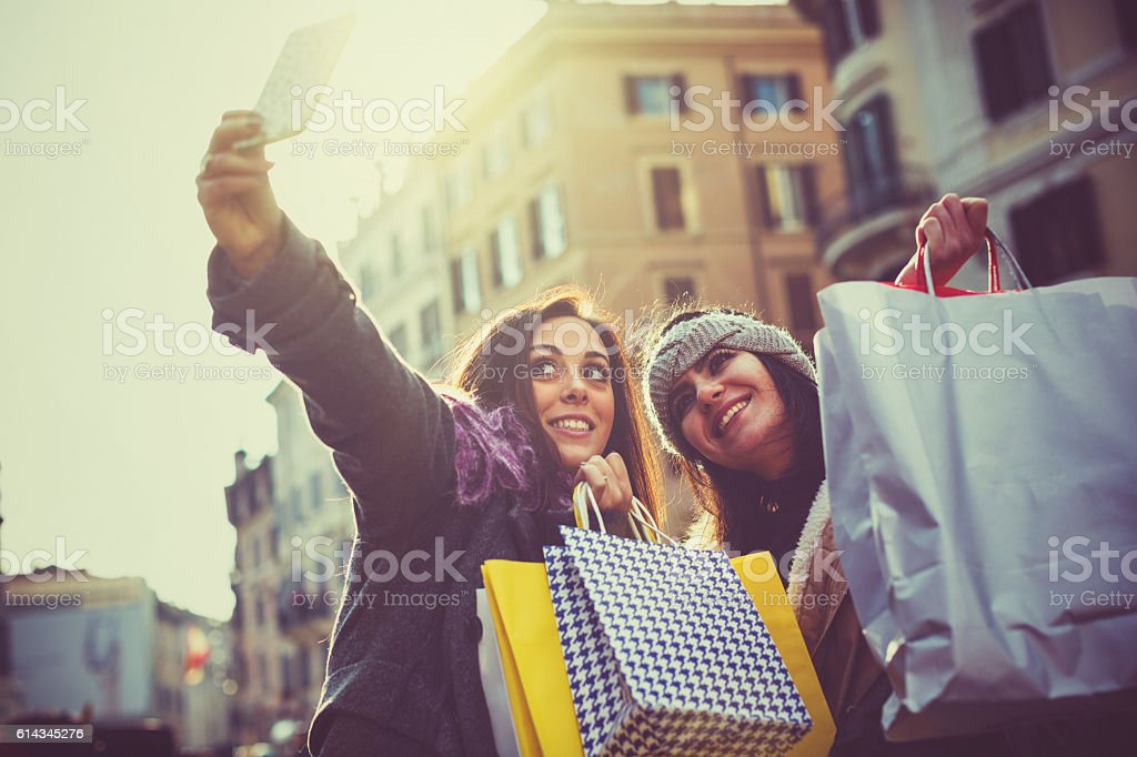 Women take a selfie during christmas shopping in Rome stock photo