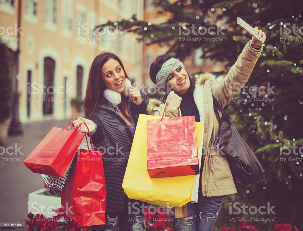 Women take a selfie during shopping in Rome stock photo