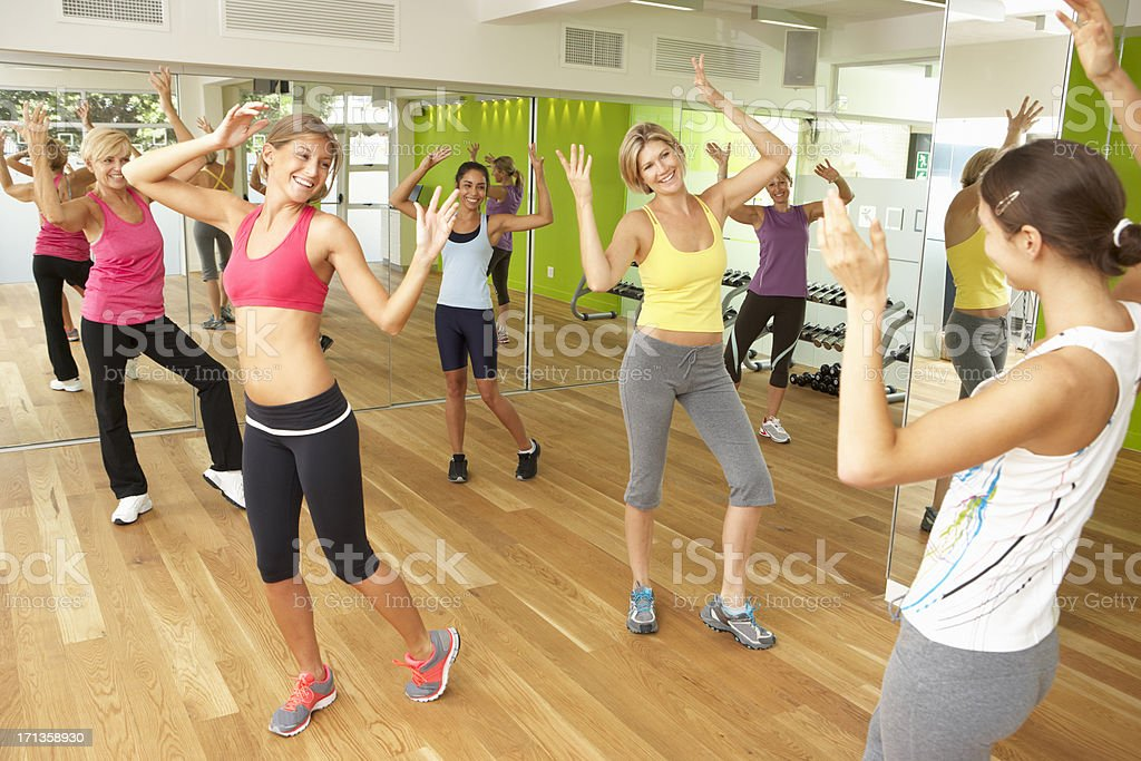 Women Taking Part In Gym Fitness Class royalty-free stock photo