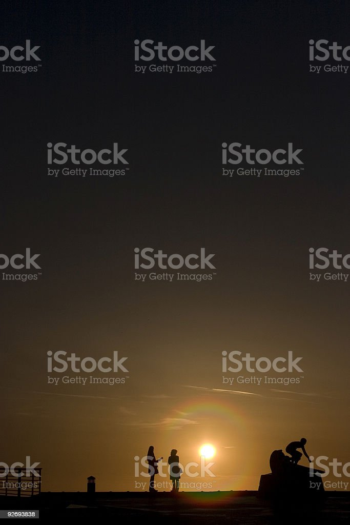 Women talk at sunset royalty-free stock photo