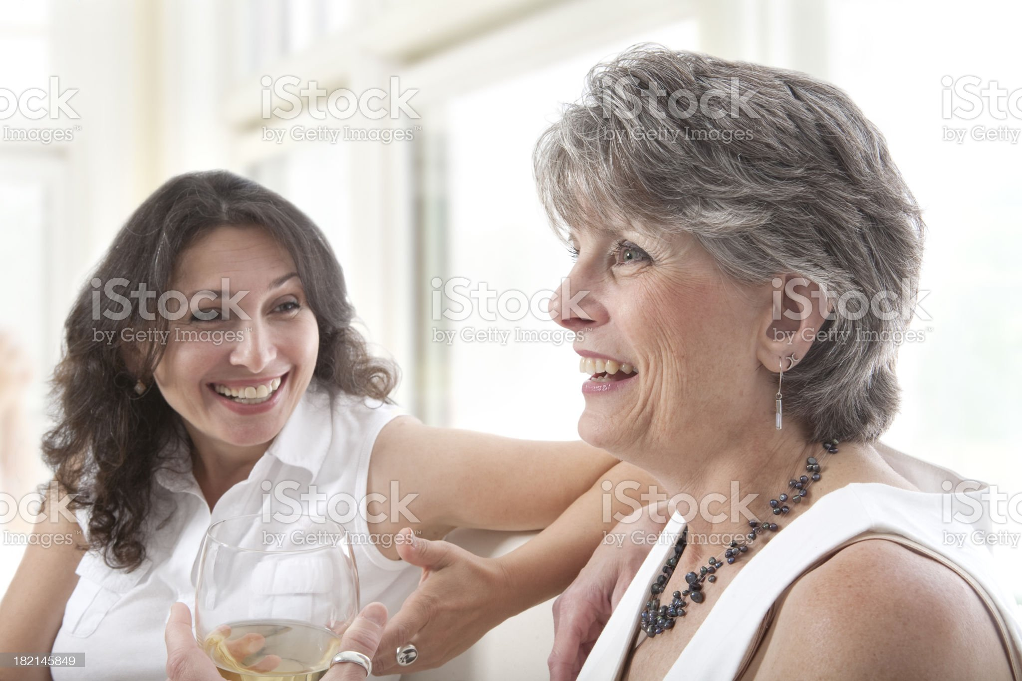 Women talking and laughing. royalty-free stock photo