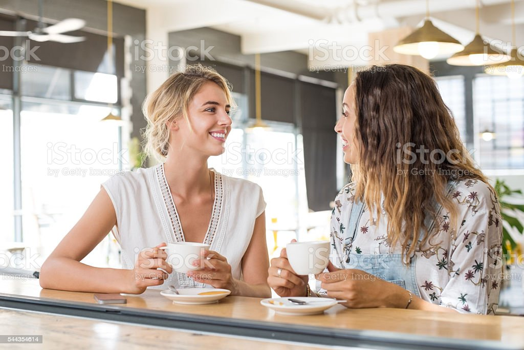 Women talking over coffee stock photo
