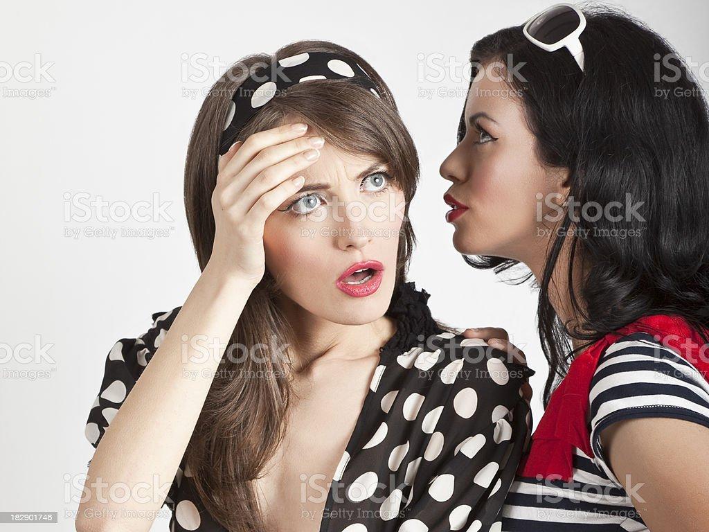 Women telling secret royalty-free stock photo