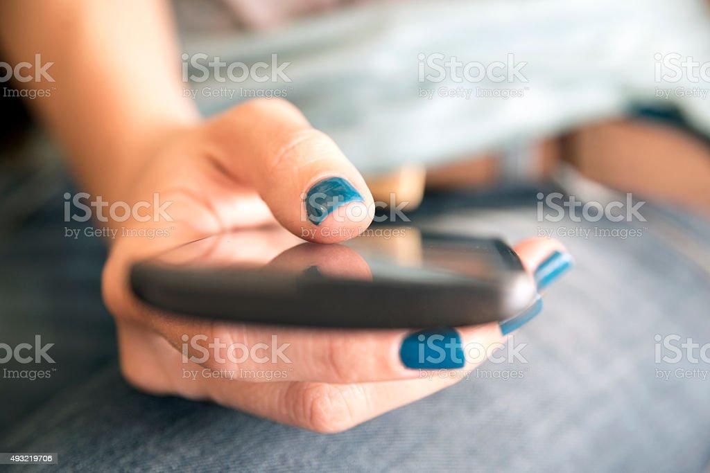 Women texting stock photo
