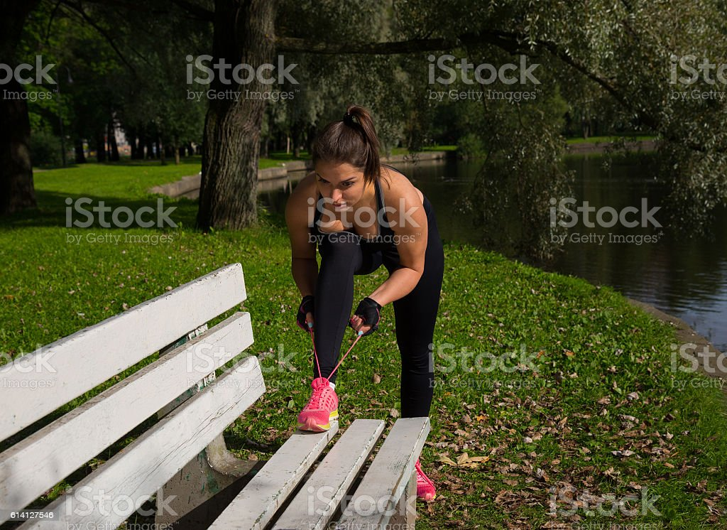 Women tied the laces on sport shoes. stock photo