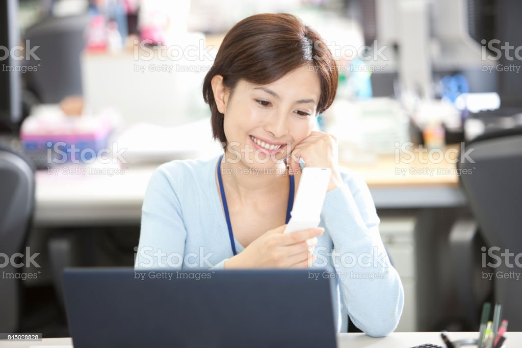 Women to email in the smiles stock photo