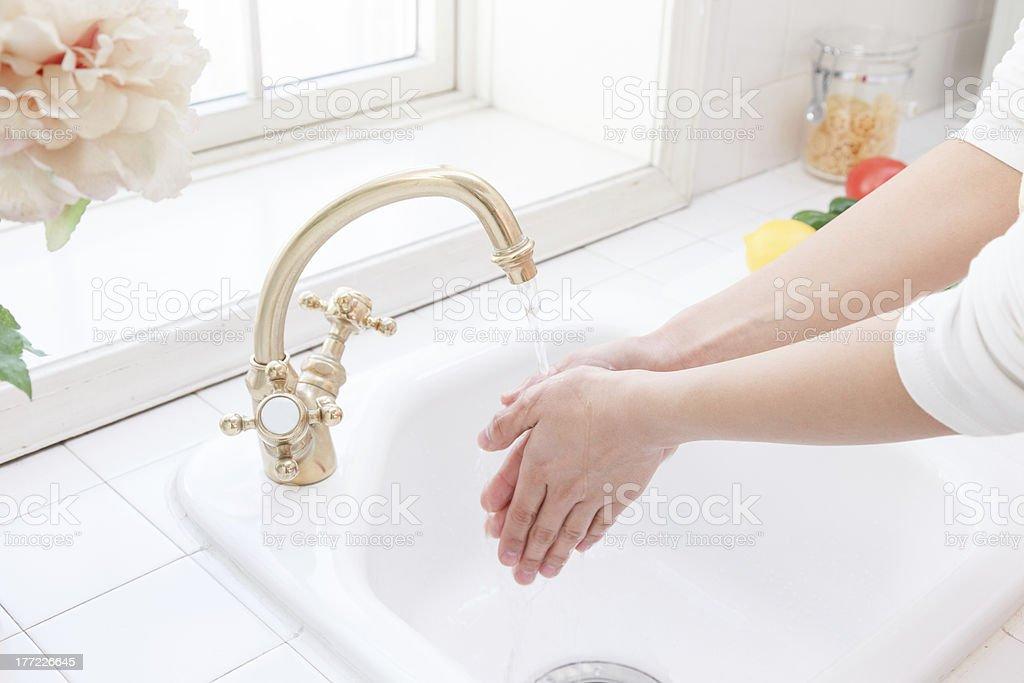 Women to hand washing royalty-free stock photo