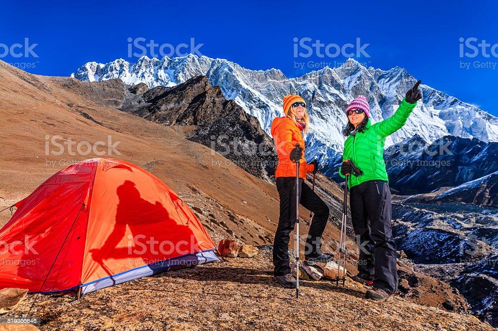 Women trekking in Himalayas, Mount Everest National Park stock photo