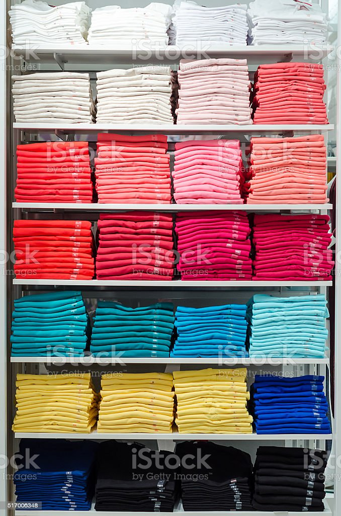 women T-shirts on a shelf in a boutique stock photo