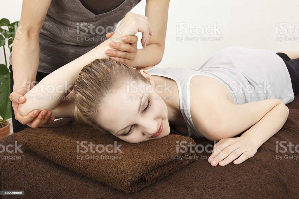 Women undergoing a massage royalty-free stock photo