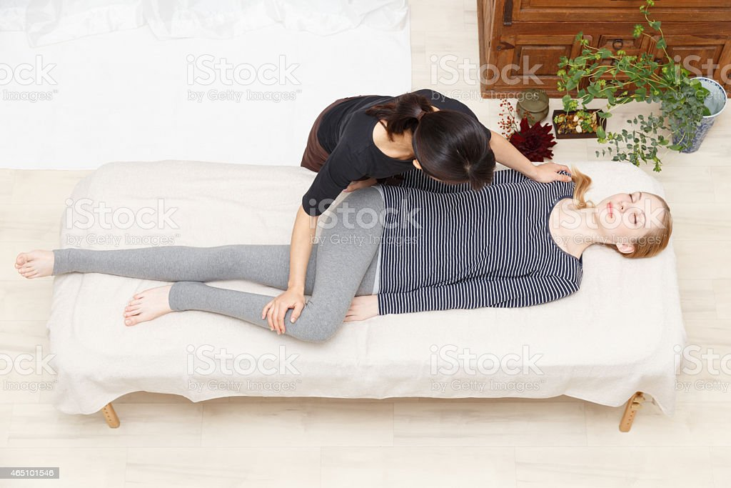 Women undergoing a massage stock photo