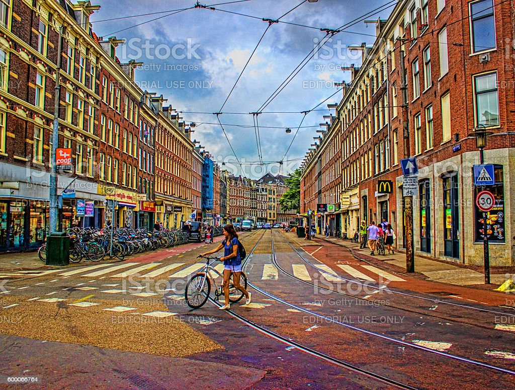 Women using bicycle in Amsterdam, Netherlands stock photo