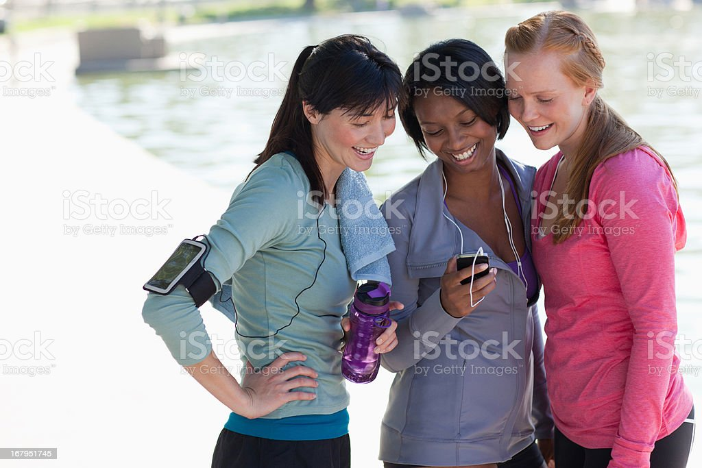 Women using cell phone together royalty-free stock photo