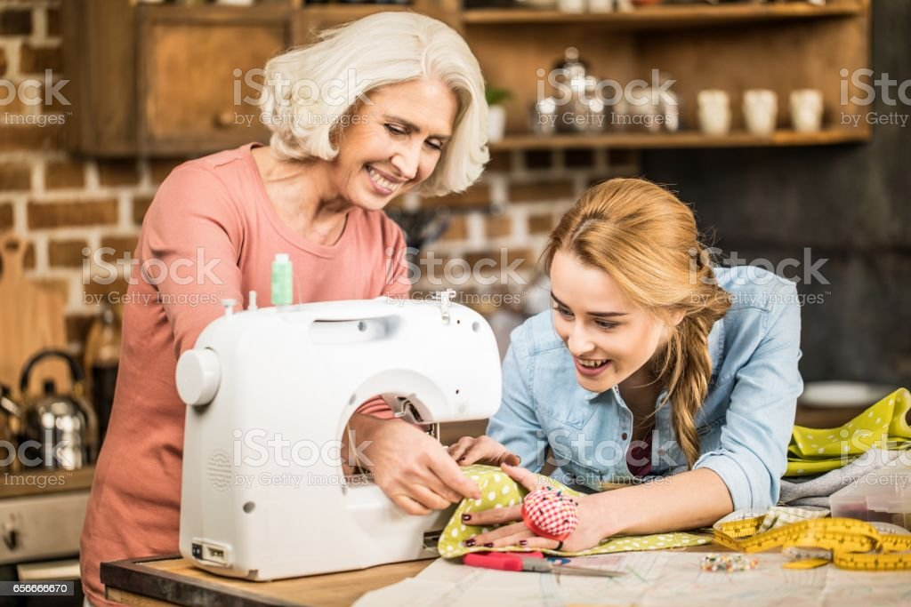 Women using sewing machine stock photo