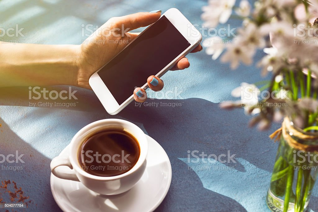 Women Using Smartphone at Coffee Shop stock photo