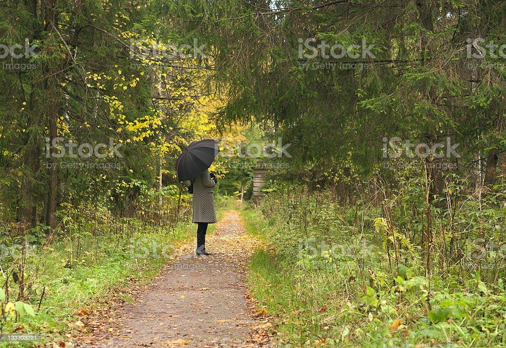 women vaiting long alley at fall autumn season royalty-free stock photo