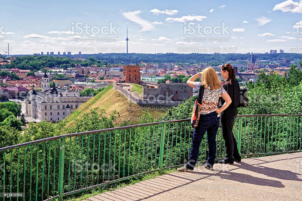 Women viewing the Gediminas Tower and the Lower Castle Vilnius stock photo