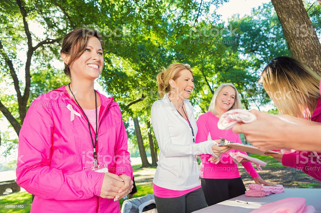 Women volunteering to raise money for breast cancer research stock photo