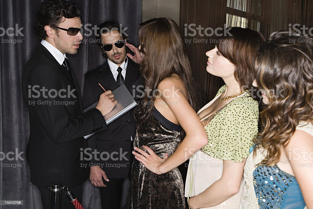 Women waiting to get into nightclub stock photo