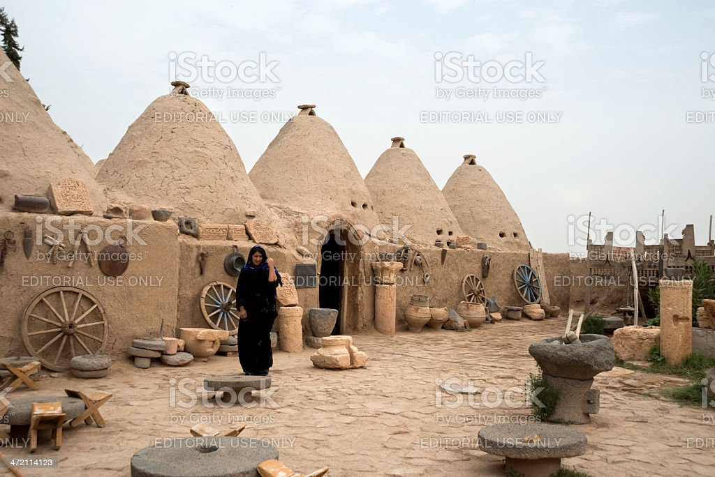 Women walking at mud brick house of harran royalty-free stock photo