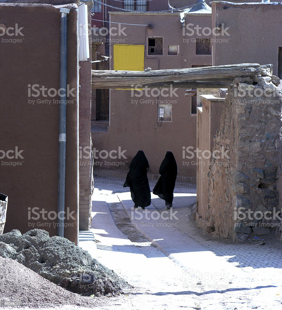 Women walking in Abyaneh stock photo