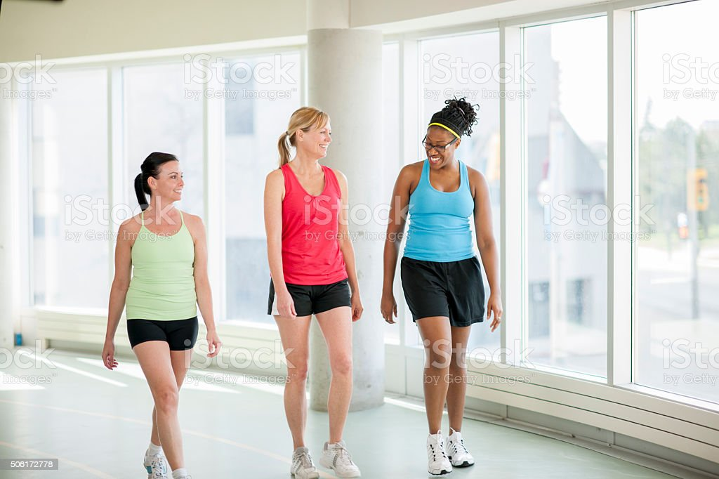 Women Walking Together at the Gym stock photo