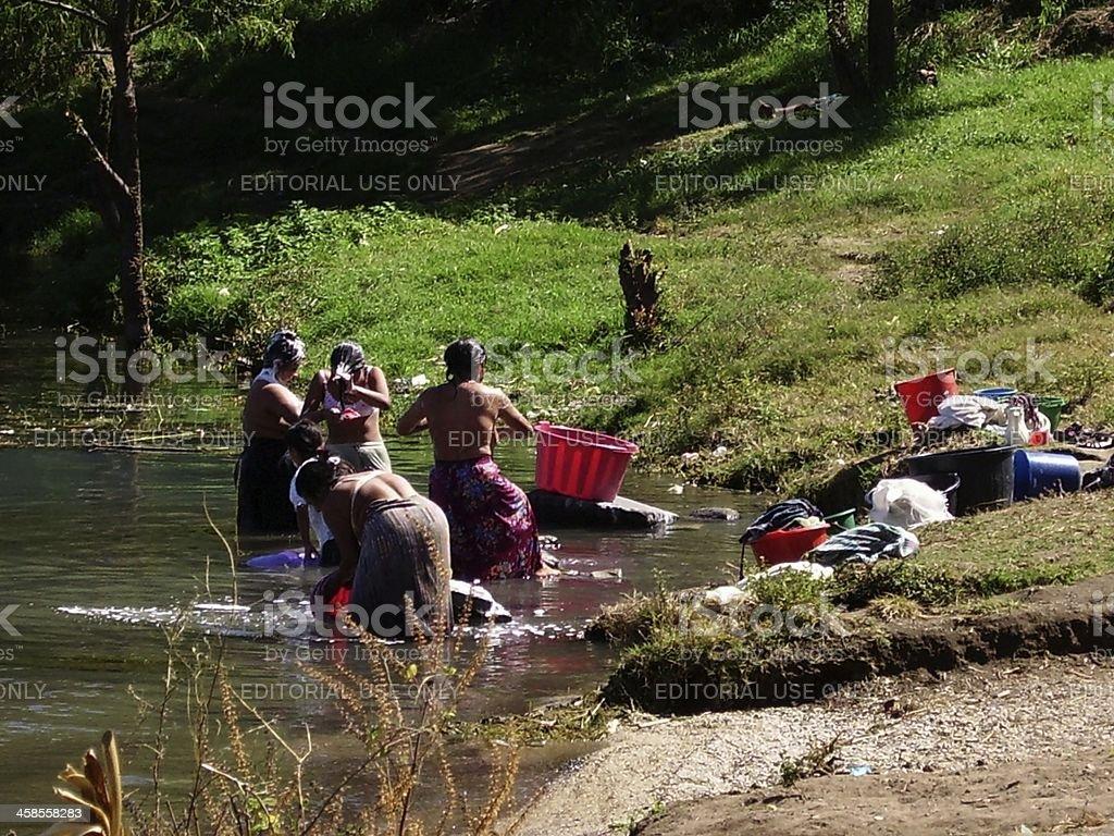Women washing clothes in Atitlan lake, Guatemala royalty-free stock photo