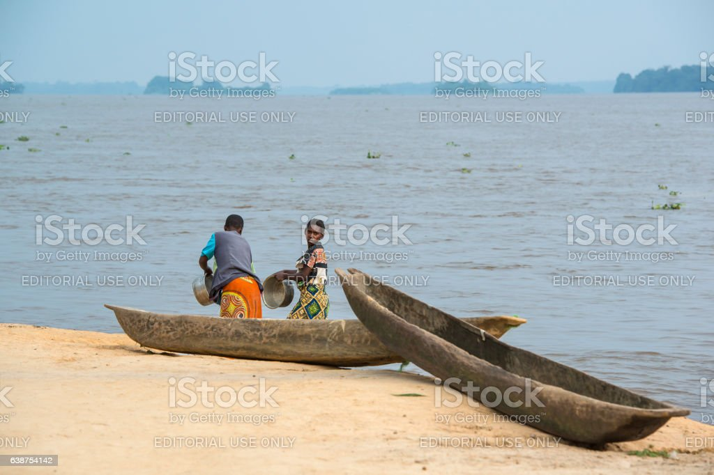 Women washing dishes in the Congo River stock photo