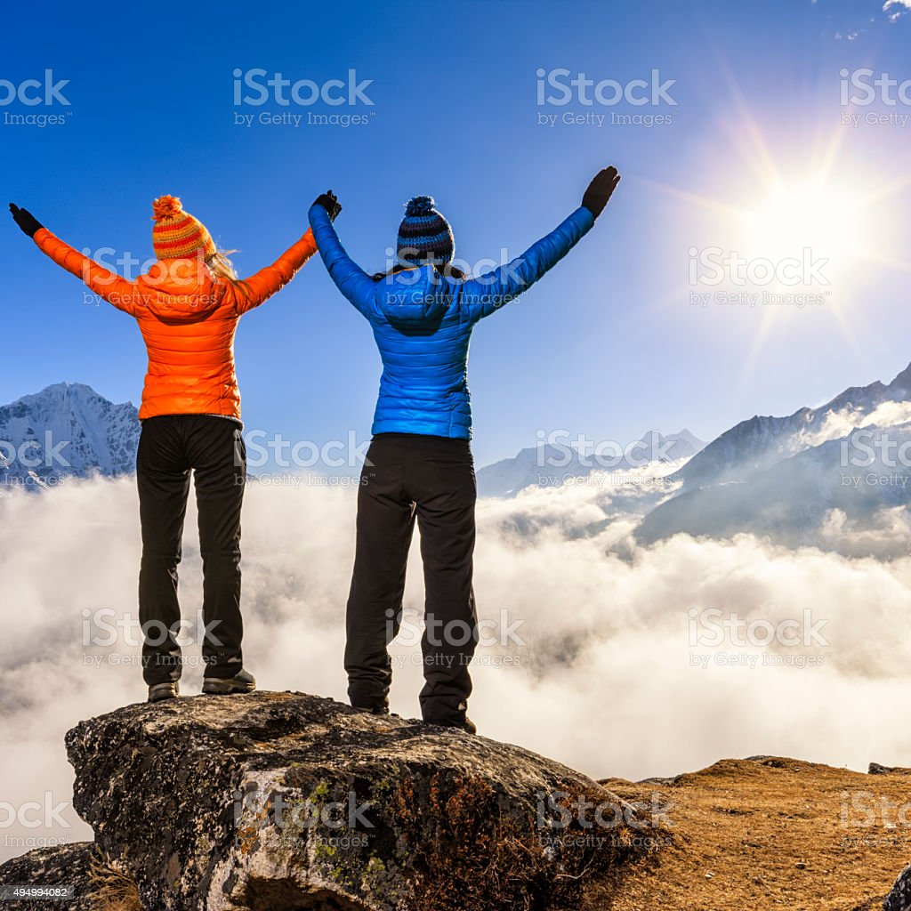 Women watching sunset over Himalayas, Mount Everest National Park stock photo