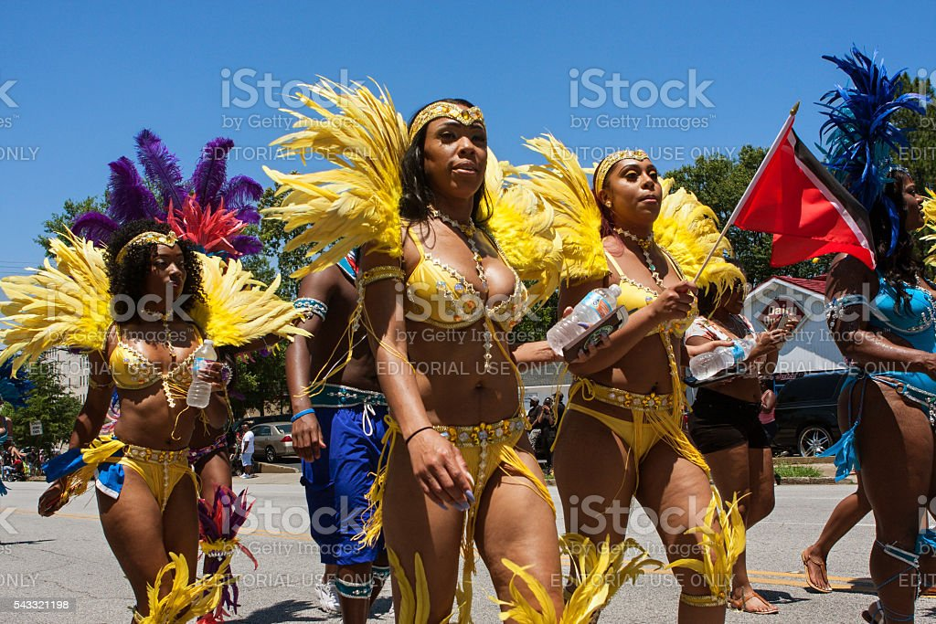 Women Wearing Bikinis Walk In Parade Celebrating Caribbean Culture stock photo