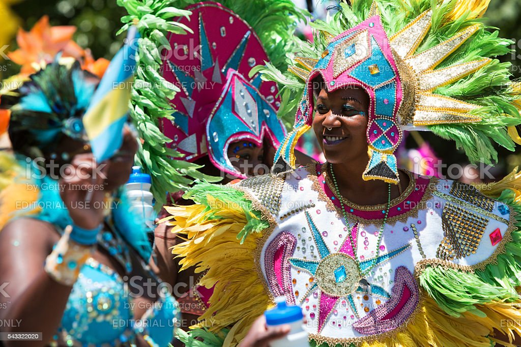 Women Wearing Elaborate Feathered Costumes Celebrate Caribbean Culture stock photo