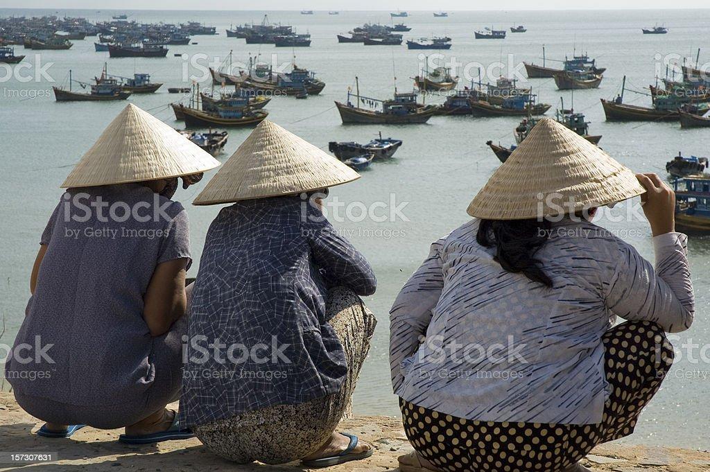 Women Wearing Traditional Ao Dai Hats In Mui Ne, Vietnam royalty-free stock photo