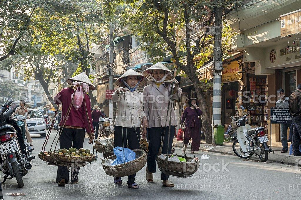 Women Wearing Traditional Non La Hats In Hanoi, Vietnam stock photo