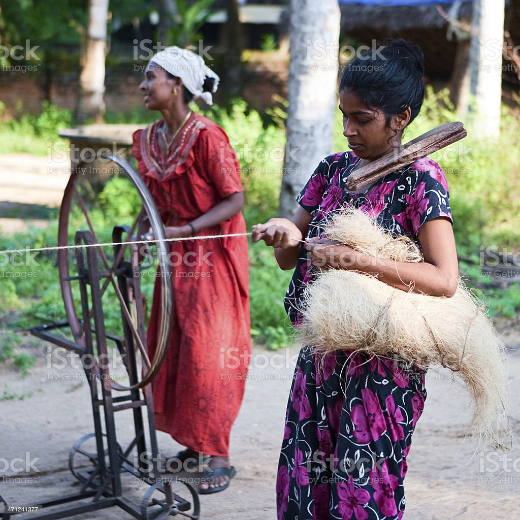 Women weaving a rope royalty-free stock photo