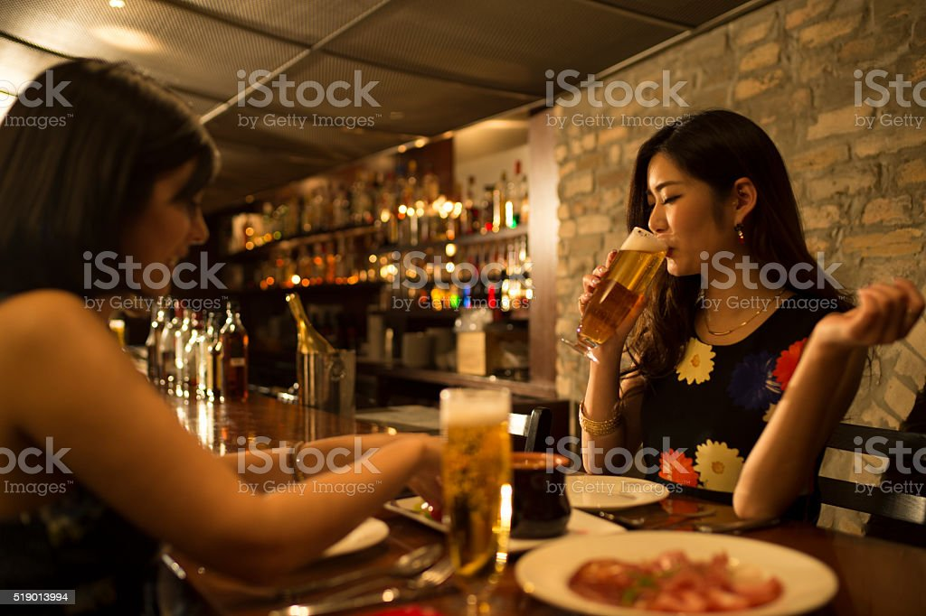 Women who are delicious to eat in the restaurant stock photo