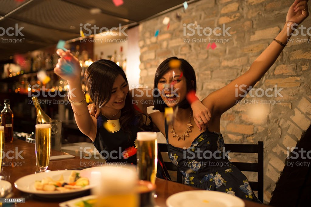 Women who are raised in a birthday party stock photo