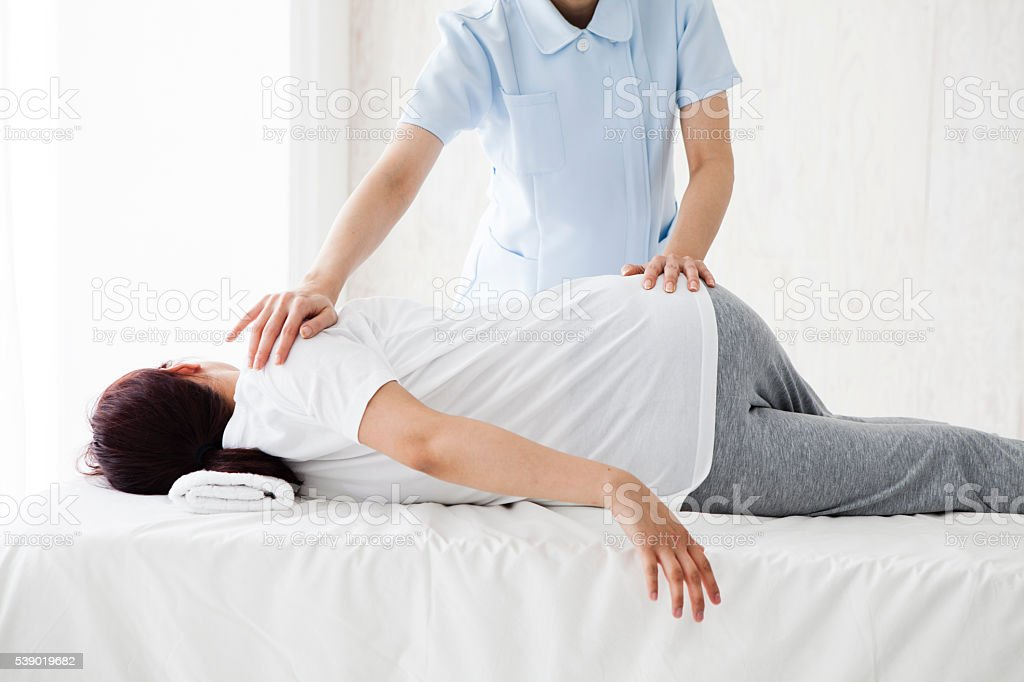 Women who are stretching in the clinic for health stock photo