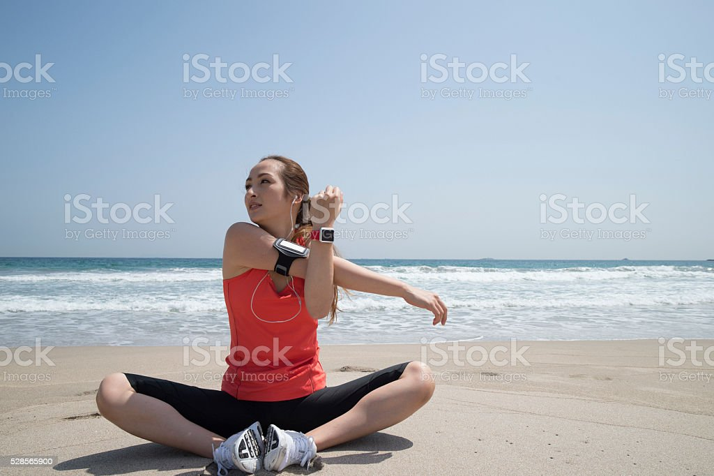 Women who are training at the seaside stock photo