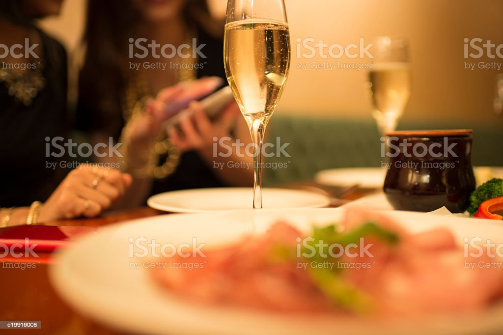 Women who are using smartphones in the restaurant stock photo