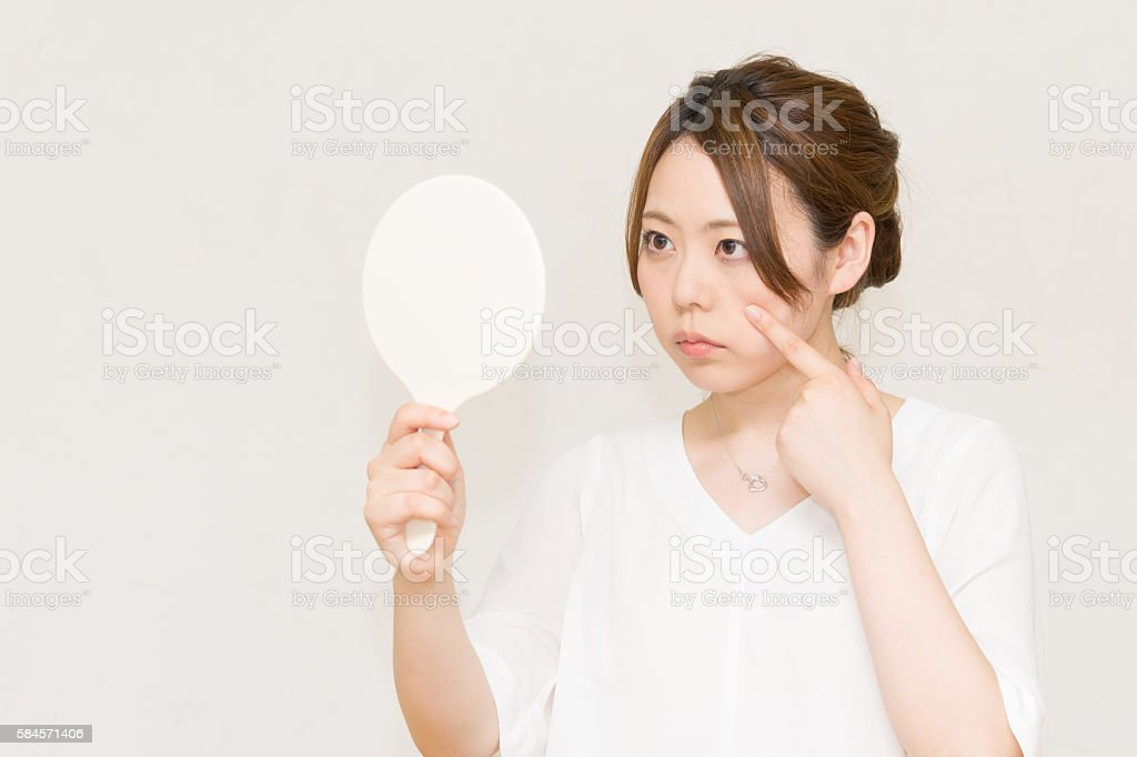 Women who look in the mirror (beauty image) stock photo
