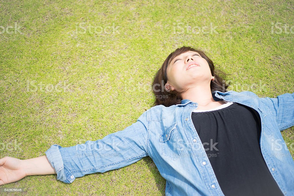 Women who sleep comfortably unlikely in the lawn stock photo