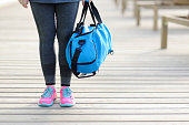 Women with a blue sports bag. Before training.